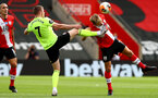 SOUTHAMPTON, ENGLAND - JULY 26: John Lundstram (L) of Sheffield and James Ward-Prowse (R) of Southampton during the Premier League match between Southampton FC and Sheffield United at St Mary's Stadium on April 17, 2020 in Southampton, United Kingdom. (Photo by Matt Watson/Southampton FC via Getty Images)