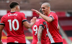 SOUTHAMPTON, ENGLAND - JULY 26: Ché Adams (L) and Oriol Romeu celebrating Ché Adams second goal during the Premier League match between Southampton FC and Sheffield United at St Mary's Stadium on April 17, 2020 in Southampton, United Kingdom. (Photo by Chris Moorhouse/Southampton FC via Getty Images)