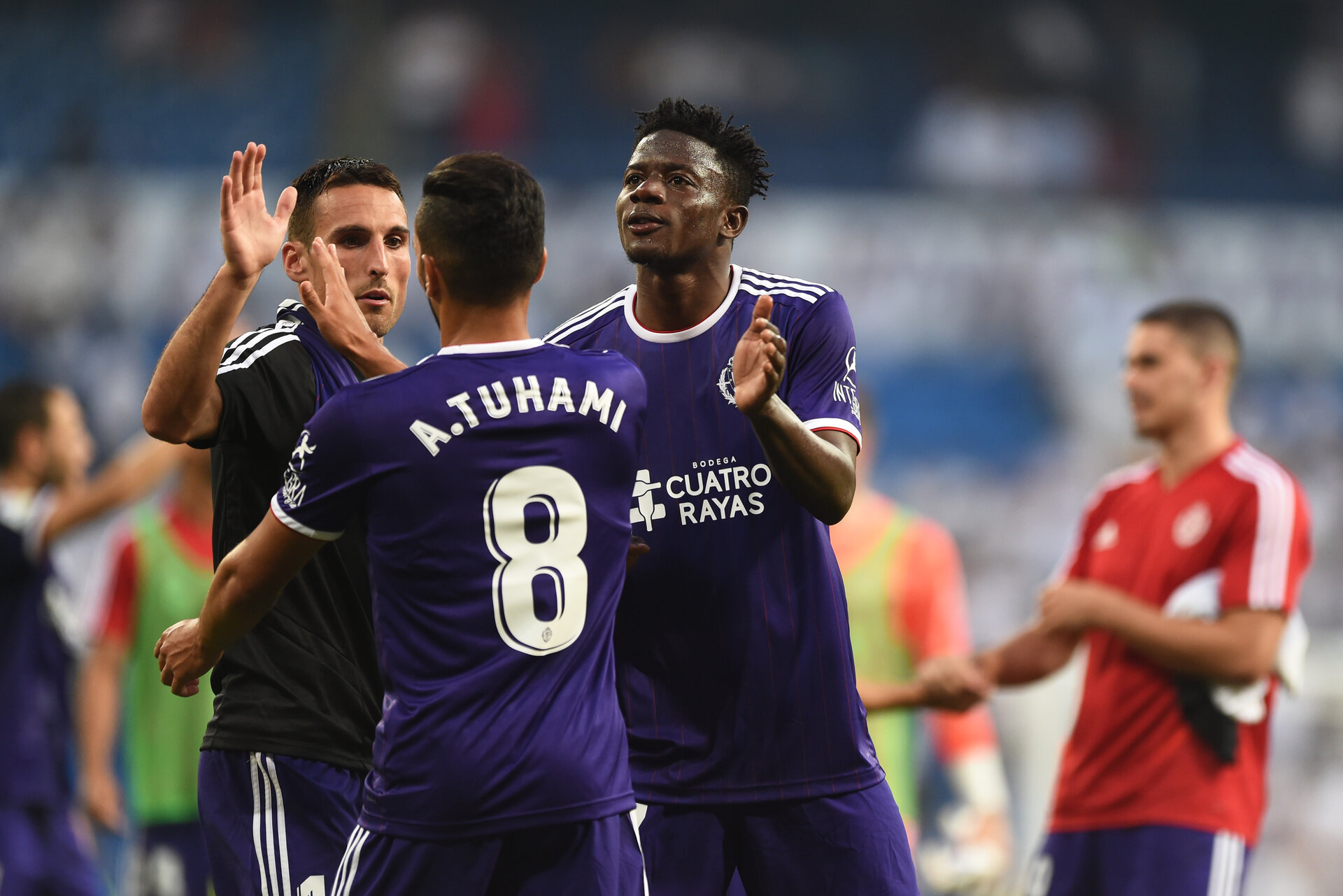 MADRID, SPAIN - AUGUST 24: Mohammed Salisu of Real Valladolid and Anuar of Real Valladolid celebrate after drawing during the La Liga match between Real Madrid CF and Real Valladolid CF at Estadio Santiago Bernabeu on August 24, 2019 in Madrid, Spain. (Photo by Denis Doyle/Getty Images)