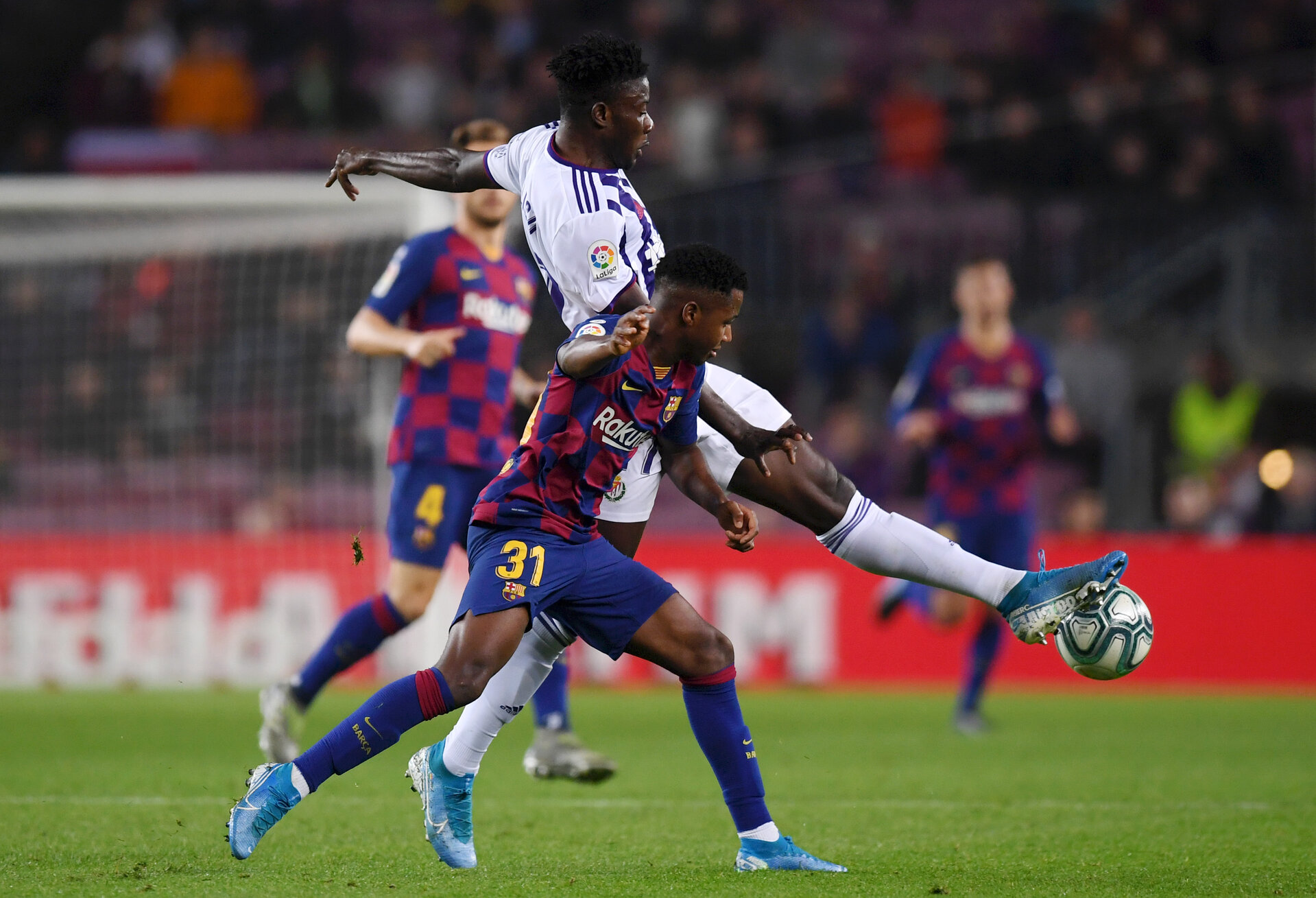 BARCELONA, SPAIN - OCTOBER 29: Mohammed Salisu of Valladolid is challenged by Anssumane Fati of FC Barcelona during the Liga match between FC Barcelona and Real Valladolid CF at Camp Nou on October 29, 2019 in Barcelona, Spain. (Photo by Alex Caparros/Getty Images)