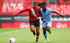 SOUTHAMPTON, ENGLAND - SEPTEMBER 1: Yan Valery (L) of Southampton batteling for the ball during a pre-season friendly match between Southampton U23 and Coventry City at St Mary's Stadium on September 1, 2020 in Southampton, United Kingdom. (Photo by Isabelle Field/Southampton FC)