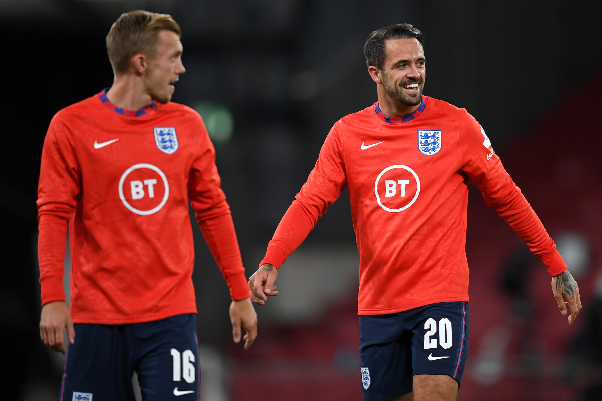 COPENHAGEN, DENMARK - SEPTEMBER 08: Danny Ings of England (R) laughs during warm ups prior to the UEFA Nations League group stage match between Denmark and England at Parken Stadium on September 08, 2020 in Copenhagen, Denmark. (Photo by Michael Regan/Getty Images)