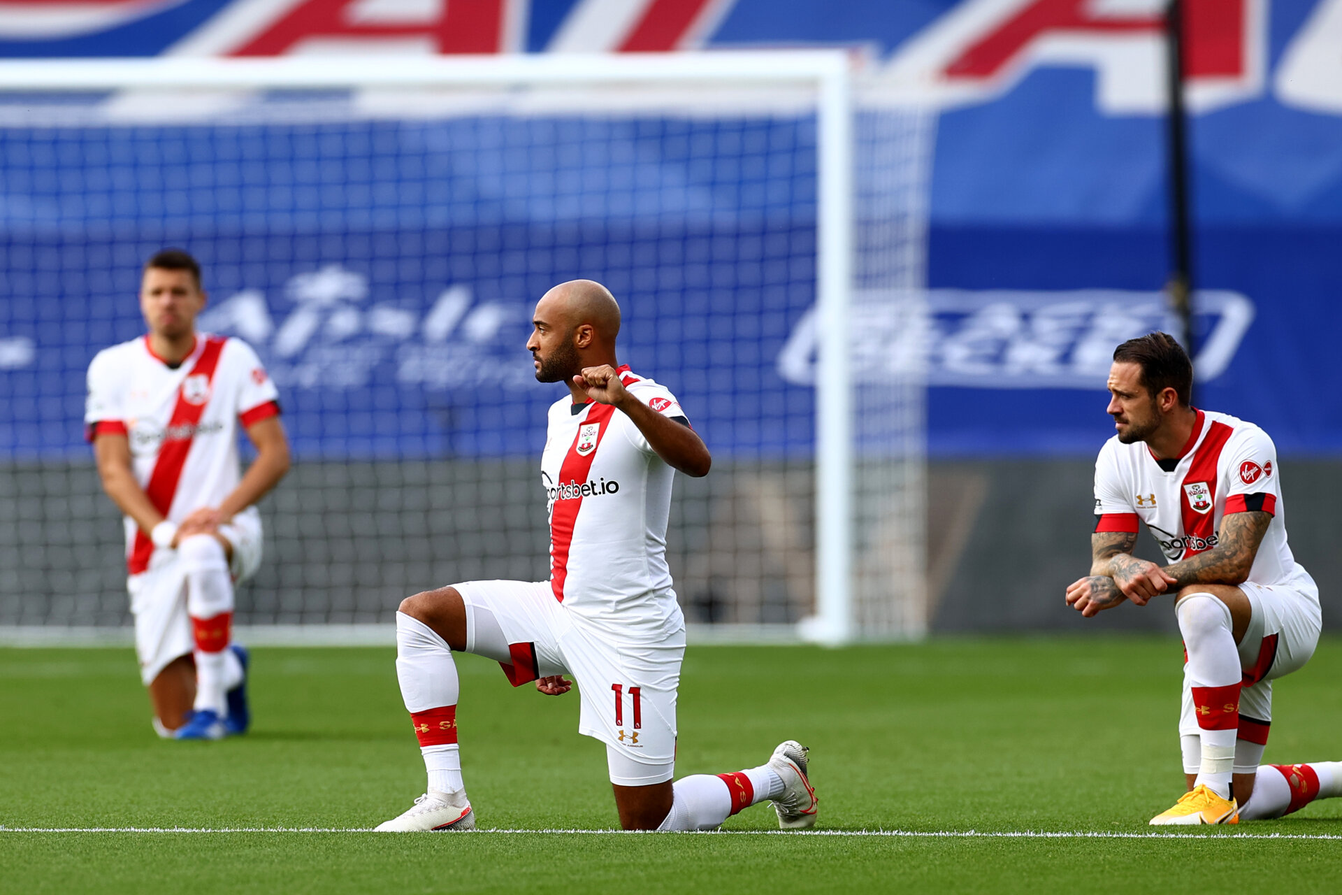 LONDON, ENGLAND - SEPTEMBER 12: Nathan Redmond (center) of Southampton taking a knee in support of black lives matter movment ahead of the Premier League match between Crystal Palace and Southampton at Selhurst Park on September 12, 2020 in London, United Kingdom. (Photo by Matt Watson/Southampton FC via Getty Images)