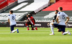 SOUTHAMPTON, ENGLAND - SEPTEMBER 20: Moussa Djenepo of Southampton takes a knee during the Premier League match between Southampton and Tottenham Hotspur at St Mary's Stadium on September 20, 2020 in Southampton, United Kingdom. (Photo by Matt Watson/Southampton FC via Getty Images)