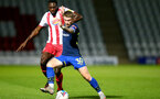 STEVENAGE, ENGLAND - SEPTEMBER 22: Init Effiong (L) of Stevenage and Callum Slattery (R) of Southampton during the EFL Trophy match between Stevenage FC and Southampton FC B Team  at the Lamex Stadium on September 22, 2020 in Stevenage, England. (Photo by Isabelle Field/Southampton FC via Getty Images)