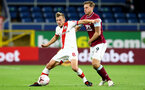BURNLEY, ENGLAND - SEPTEMBER 26: James Ward-Prowse (L) of Southampton and Chris Wood (R) of Burnley during the Premier League match between Burnley and Southampton at Turf Moor on September 26, 2020 in Burnley, United Kingdom. Sporting stadiums around the UK remain under strict restrictions due to the Coronavirus Pandemic as Government social distancing laws prohibit fans inside venues resulting in games being played behind closed doors. (Photo by Matt Watson/Southampton FC via Getty Images)