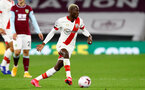 BURNLEY, ENGLAND - SEPTEMBER 26: Moussa Djenepo of Southampton during the Premier League match between Burnley and Southampton at Turf Moor on September 26, 2020 in Burnley, United Kingdom. Sporting stadiums around the UK remain under strict restrictions due to the Coronavirus Pandemic as Government social distancing laws prohibit fans inside venues resulting in games being played behind closed doors. (Photo by Matt Watson/Southampton FC via Getty Images)