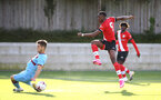 SOUTHAMPTON, ENGLAND - SEPTEMBER 26: Dan N'Lundulu (R) of Southampton strike on goal during Premier League 2 Match between Southampton B Team and West Ham United at Staplewood Training Ground on September 26, 2020 in Southampton, England. (Photo by Isabelle Field/Southampton FC via Getty Images)