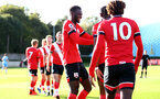 SOUTHAMPTON, ENGLAND - SEPTEMBER 26: Pascal Kpohomouh (L) congratulating Dan N'Lundulu (obstructed) on first goal during Premier League 2 Match between Southampton B Team and West Ham United at Staplewood Training Ground on September 26, 2020 in Southampton, England. (Photo by Isabelle Field/Southampton FC via Getty Images)