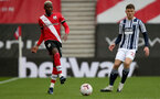 SOUTHAMPTON, ENGLAND - OCTOBER 04: Moussa Djenepo (L) of Southampton and Dara O'Shea (R) of West Bromwich Albion during the Premier League match between Southampton and West Bromwich Albion at St Mary's Stadium on October 4, 2020 in Southampton, United Kingdom. Sporting stadiums around the UK remain under strict restrictions due to the Coronavirus Pandemic as Government social distancing laws prohibit fans inside venues resulting in games being played behind closed doors. (Photo by Chris Moorhouse/Southampton FC via Getty Images)