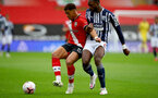 SOUTHAMPTON, ENGLAND - OCTOBER 04: Ché Adams (L) of Southampton and Oluwasemilogo Ajayi (R) of West Bromwich Albion during the Premier League match between Southampton and West Bromwich Albion at St Mary's Stadium on October 4, 2020 in Southampton, United Kingdom. Sporting stadiums around the UK remain under strict restrictions due to the Coronavirus Pandemic as Government social distancing laws prohibit fans inside venues resulting in games being played behind closed doors. (Photo by Matt Watson/Southampton FC via Getty Images)