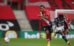 SOUTHAMPTON, ENGLAND - OCTOBER 04: Ryan Bertrand (L) of Southampton and Kyle Edwards (R) of WestBromwich Albion during the Premier League match between Southampton and West Bromwich Albion at St Mary's Stadium on October 4, 2020 in Southampton, United Kingdom. Sporting stadiums around the UK remain under strict restrictions due to the Coronavirus Pandemic as Government social distancing laws prohibit fans inside venues resulting in games being played behind closed doors. (Photo by Matt Watson/Southampton FC via Getty Images)