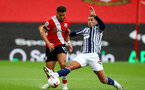 SOUTHAMPTON, ENGLAND - OCTOBER 04: Ché Adams (L) of Southampton and Jake Livermore (R) of WestBromwich Albion during the Premier League match between Southampton and West Bromwich Albion at St Mary's Stadium on October 4, 2020 in Southampton, United Kingdom. Sporting stadiums around the UK remain under strict restrictions due to the Coronavirus Pandemic as Government social distancing laws prohibit fans inside venues resulting in games being played behind closed doors. (Photo by Matt Watson/Southampton FC via Getty Images)