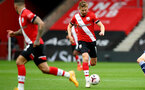 SOUTHAMPTON, ENGLAND - OCTOBER 04: Stuart Armstrong (R) of Southampton during the Premier League match between Southampton and West Bromwich Albion at St Mary's Stadium on October 4, 2020 in Southampton, United Kingdom. Sporting stadiums around the UK remain under strict restrictions due to the Coronavirus Pandemic as Government social distancing laws prohibit fans inside venues resulting in games being played behind closed doors. (Photo by Matt Watson/Southampton FC via Getty Images)
