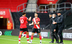 SOUTHAMPTON, ENGLAND - OCTOBER 04: Ché Adams (L) of Southampton coming off for Shane Long (R) of Southampton during the Premier League match between Southampton and West Bromwich Albion at St Mary's Stadium on October 4, 2020 in Southampton, United Kingdom. Sporting stadiums around the UK remain under strict restrictions due to the Coronavirus Pandemic as Government social distancing laws prohibit fans inside venues resulting in games being played behind closed doors. (Photo by Matt Watson/Southampton FC via Getty Images)