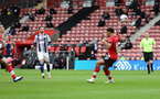 SOUTHAMPTON, ENGLAND - OCTOBER 04: Oriol Romeu (left) scores during the Premier League match between Southampton and West Bromwich Albion at St Mary's Stadium on October 4, 2020 in Southampton, United Kingdom. Sporting stadiums around the UK remain under strict restrictions due to the Coronavirus Pandemic as Government social distancing laws prohibit fans inside venues resulting in games being played behind closed doors. (Photo by Chris Moorhouse/Southampton FC via Getty Images)