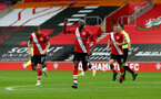 SOUTHAMPTON, ENGLAND - OCTOBER 04: Moussa Djenepo of Southampton celebrates his goal during the Premier League match between Southampton and West Bromwich Albion at St Mary's Stadium on October 04, 2020 in Southampton, United Kingdom. Sporting stadiums around the UK remain under strict restrictions due to the Coronavirus Pandemic as Government social distancing laws prohibit fans inside venues resulting in games being played behind closed doors. (Photo by Matt Watson/Southampton FC via Getty Images)