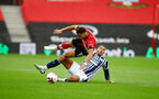 SOUTHAMPTON, ENGLAND - OCTOBER 04: Ché Adams(L) of Southampton is fouled by Jake Livermore of West Bromwich Albion during the Premier League match between Southampton and West Bromwich Albion at St Mary's Stadium on October 04, 2020 in Southampton, United Kingdom. Sporting stadiums around the UK remain under strict restrictions due to the Coronavirus Pandemic as Government social distancing laws prohibit fans inside venues resulting in games being played behind closed doors. (Photo by Matt Watson/Southampton FC via Getty Images)