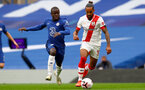 LONDON, ENGLAND - OCTOBER 17: N'Colo Kante (L) of Chelsea and Theo Walcott (R) of Southampton during the Premier League match between Chelsea and Southampton at Stamford Bridge on October 17, 2020 in London, United Kingdom. Sporting stadiums around the UK remain under strict restrictions due to the Coronavirus Pandemic as Government social distancing laws prohibit fans inside venues resulting in games being played behind closed doors. (Photo by Matt Watson/Southampton FC via Getty Images)