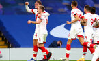 LONDON, ENGLAND - OCTOBER 17: Jannik Vestergaard (L) celebrates his goal with James Ward-Prowse (R) during the Premier League match between Chelsea and Southampton at Stamford Bridge on October 17, 2020 in London, United Kingdom. Sporting stadiums around the UK remain under strict restrictions due to the Coronavirus Pandemic as Government social distancing laws prohibit fans inside venues resulting in games being played behind closed doors. (Photo by Matt Watson/Southampton FC via Getty Images)