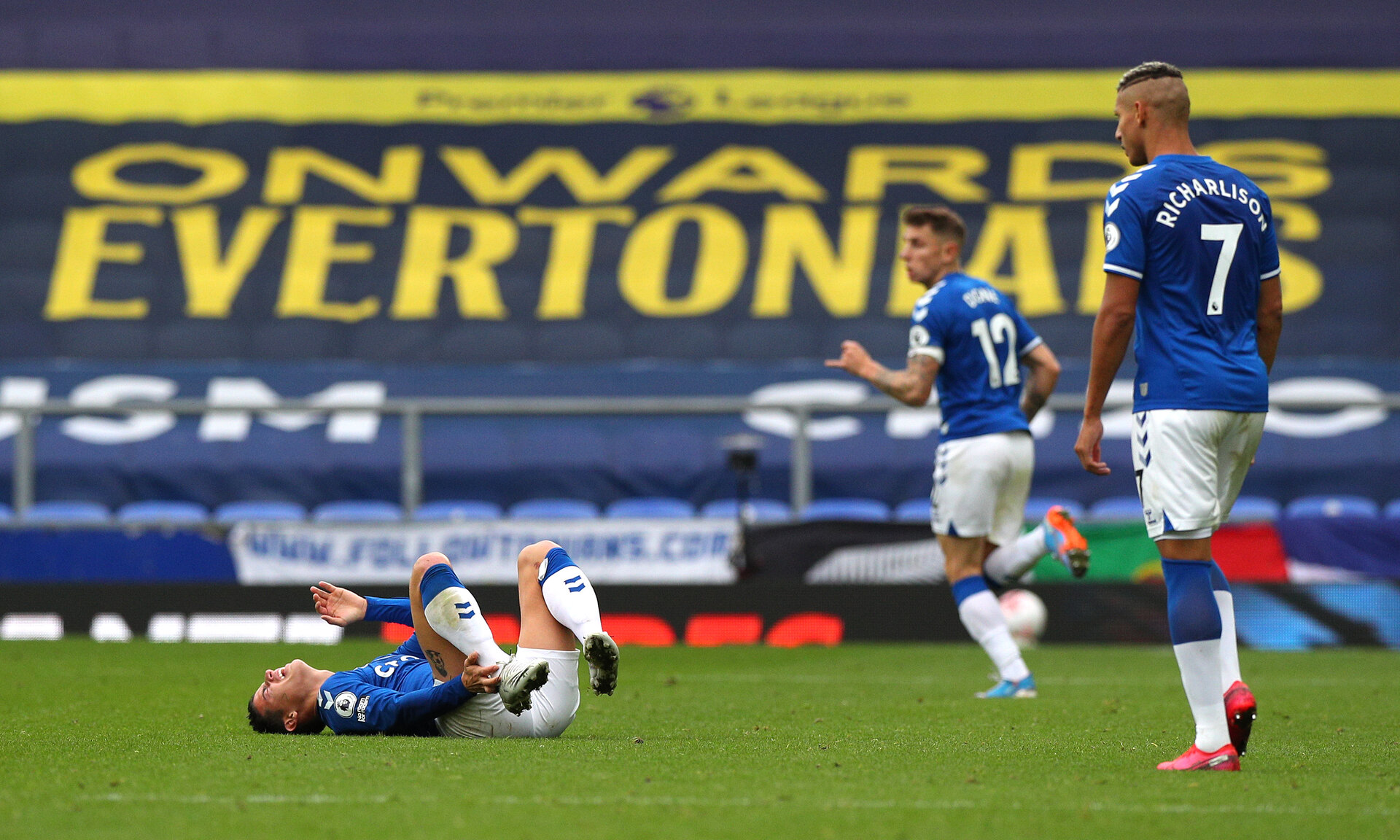 LIVERPOOL, ENGLAND - OCTOBER 17: James Rodriguez goes down injured during the Premier League match between Everton and Liverpool at Goodison Park on October 17, 2020 in Liverpool, England. Sporting stadiums around the UK remain under strict restrictions due to the Coronavirus Pandemic as Government social distancing laws prohibit fans inside venues resulting in games being played behind closed doors. (Photo by Peter Byrne - Pool/Getty Images)