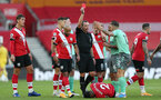 SOUTHAMPTON, ENGLAND - OCTOBER 25: Lucas Digne of Everton receiving a red card  during the Premier League match between Southampton and Everton at St Mary's Stadium on October 25, 2020 in Southampton, England. Sporting stadiums around the UK remain under strict restrictions due to the Coronavirus Pandemic as Government social distancing laws prohibit fans inside venues resulting in games being played behind closed doors. (Photo by Matt Watson/Southampton FC via Getty Images)