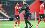 SOUTHAMPTON, ENGLAND - OCTOBER 25: Kyle Walker-Peters(L) and Ralph Hasenhuttl(R) of Southampton during the Premier League match between Southampton and Everton at St Mary's Stadium on October 25, 2020 in Southampton, England. Sporting stadiums around the UK remain under strict restrictions due to the Coronavirus Pandemic as Government social distancing laws prohibit fans inside venues resulting in games being played behind closed doors. (Photo by Matt Watson/Southampton FC via Getty Images)