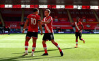 SOUTHAMPTON, ENGLAND - OCTOBER 25: Che Adams(L) of Southampton celebrates with James Ward-Prowse after scoring his teams second goal during the Premier League match between Southampton and Everton at St Mary's Stadium on October 25, 2020 in Southampton, England. Sporting stadiums around the UK remain under strict restrictions due to the Coronavirus Pandemic as Government social distancing laws prohibit fans inside venues resulting in games being played behind closed doors. (Photo by Matt Watson/Southampton FC via Getty Images)