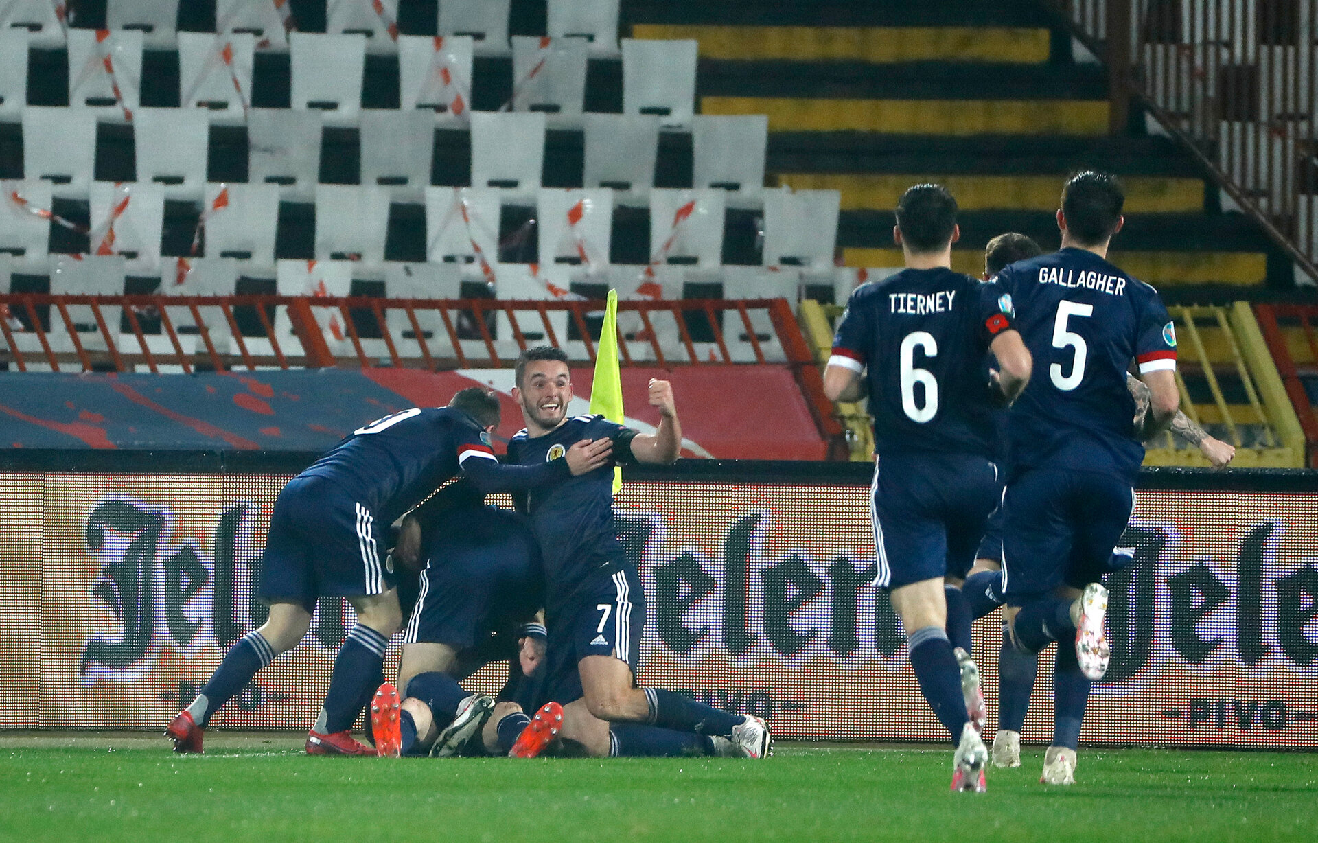 BELGRADE, SERBIA - NOVEMBER 12: Ryan Christie of Scotland  celebrates after scoring his team's first goal with his team during the UEFA EURO 2020 Play-Off Final between Serbia and Scotland at Rajko Mitic Stadium on November 12, 2020 in Belgrade, Serbia. Football Stadiums around Europe remain empty due to the Coronavirus Pandemic as Government social distancing laws prohibit fans inside venues resulting in fixtures being played behind closed doors. (Photo by Srdjan Stevanovic/Getty Images)