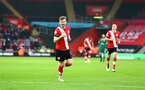 SOUTHAMPTON, ENGLAND - DECEMBER 13: Stuart Armstrong of Southampton celebrates after making it 2-0 during the Premier League match between Southampton and Sheffield United at St Mary's Stadium on December 13, 2020 in Southampton, England. A limited number of spectators (2000) are welcomed back to stadiums to watch elite football across England. This was following easing of restrictions on spectators in tiers one and two areas only. (Photo by Matt Watson/Southampton FC via Getty Images)