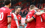 SOUTHAMPTON, ENGLAND - DECEMBER 13: Danny Ings of Southampton celebrates with his team mates during the Premier League match between Southampton and Sheffield United at St Mary's Stadium on December 13, 2020 in Southampton, England. A limited number of spectators (2000) are welcomed back to stadiums to watch elite football across England. This was following easing of restrictions on spectators in tiers one and two areas only. (Photo by Matt Watson/Southampton FC via Getty Images)