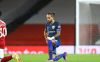 LONDON, ENGLAND - DECEMBER 16: Theo Walcott of Southampton takes a knee in support of the Black Lives Matter movement during the Premier League match between Arsenal and Southampton at Emirates Stadium on December 16, 2020 in London, England. The match will be played without fans, behind closed doors as a Covid-19 precaution. (Photo by Matt Watson/Southampton FC via Getty Images)