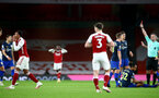 LONDON, ENGLAND - DECEMBER 16: Gabriel Magalhaes (L) of Arsenal received second yellow after fouling Theo Walcott of Southampton during the Premier League match between Arsenal and Southampton at Emirates Stadium on December 16, 2020 in London, England. The match will be played without fans, behind closed doors as a Covid-19 precaution. (Photo by Matt Watson/Southampton FC via Getty Images)