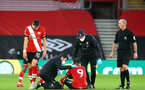 SOUTHAMPTON, ENGLAND - DECEMBER 19: Danny Ings of Southampton receiving treatment during the Premier League match between Southampton and Manchester City at St Mary's Stadium on December 19, 2020 in Southampton, England. A limited number of fans (2000) are welcomed back to stadiums to watch elite football across England. This was following easing of restrictions on spectators in tiers one and two areas only. (Photo by Matt Watson/Southampton FC via Getty Images)