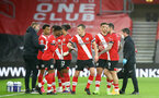 SOUTHAMPTON, ENGLAND - DECEMBER 19: Southampton players during the Premier League match between Southampton and Manchester City at St Mary's Stadium on December 19, 2020 in Southampton, England. A limited number of fans (2000) are welcomed back to stadiums to watch elite football across England. This was following easing of restrictions on spectators in tiers one and two areas only. (Photo by Matt Watson/Southampton FC via Getty Images)