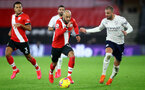 SOUTHAMPTON, ENGLAND - DECEMBER 19: Nathan Redmond(L)  of Southampton and Kyle Walker (R) Manchester City during the Premier League match between Southampton and Manchester City at St Mary's Stadium on December 19, 2020 in Southampton, England. A limited number of fans (2000) are welcomed back to stadiums to watch elite football across England. This was following easing of restrictions on spectators in tiers one and two areas only. (Photo by Matt Watson/Southampton FC via Getty Images)