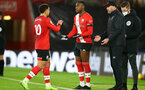 SOUTHAMPTON, ENGLAND - DECEMBER 19: Ché Adams(L) comes off for Dan N'Lundulu (R) of Southampton during the Premier League match between Southampton and Manchester City at St Mary's Stadium on December 19, 2020 in Southampton, England. A limited number of fans (2000) are welcomed back to stadiums to watch elite football across England. This was following easing of restrictions on spectators in tiers one and two areas only. (Photo by Matt Watson/Southampton FC via Getty Images)
