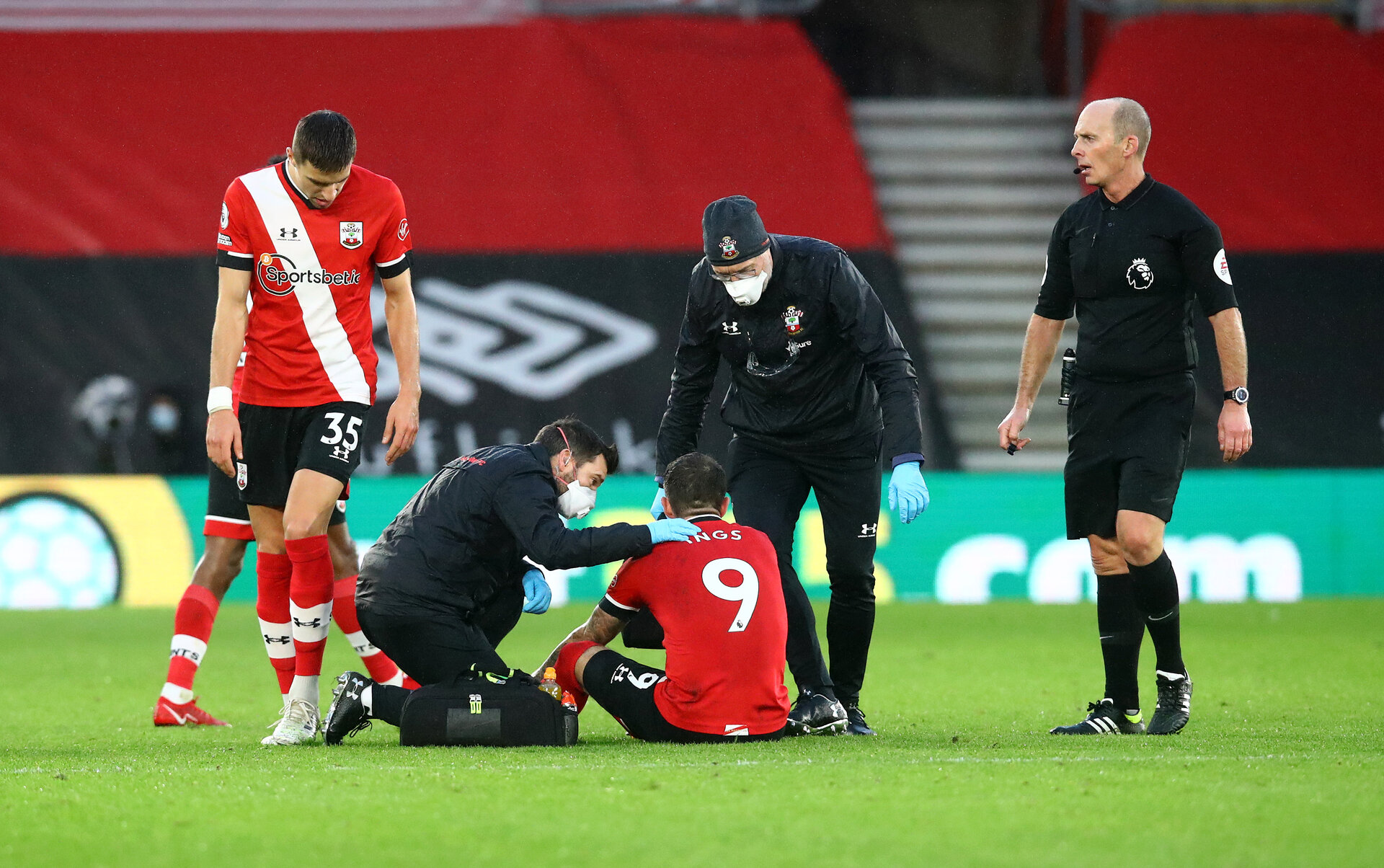 SOUTHAMPTON, ENGLAND - DECEMBER 19: Danny Ings of Southampton receives treatment during the Premier League match between Southampton and Manchester City at St Mary's Stadium on December 19, 2020 in Southampton, England. A limited number of fans (2000) are welcomed back to stadiums to watch elite football across England. This was following easing of restrictions on spectators in tiers one and two areas only. (Photo by Matt Watson/Southampton FC via Getty Images)