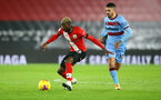 SOUTHAMPTON, ENGLAND - DECEMBER 29: Moussa Djenepo(L) of Southampton and Mnuel Lanzini(R) of West Ham during the Premier League match between Southampton and West Ham United at St Mary's Stadium on December 29, 2020 in Southampton, England. (Photo by Matt Watson/Southampton FC via Getty Images)