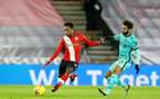 SOUTHAMPTON, ENGLAND - JANUARY 04: Kyle Walker-Peters (L) of Southampton and Mohaed Salah (R) of Liverpool during the Premier League match between Southampton and Liverpool at St Mary's Stadium on January 04, 2021 in Southampton, England. (Photo by Matt Watson/Southampton FC via Getty Images)