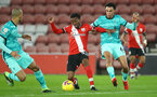 SOUTHAMPTON, ENGLAND - JANUARY 04: Nathan Tella of Southampton and Trent Alexander-Arnold (R)  of Liverpool during the Premier League match between Southampton and Liverpool at St Mary's Stadium on January 04, 2021 in Southampton, England. (Photo by Matt Watson/Southampton FC via Getty Images)