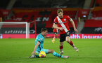 SOUTHAMPTON, ENGLAND - JANUARY 04: James Milner (L) of Liverpool and Stuart Armstrong (R) of Southampton during the Premier League match between Southampton and Liverpool at St Mary's Stadium on January 04, 2021 in Southampton, England. (Photo by Matt Watson/Southampton FC via Getty Images)