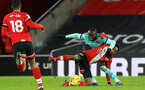 SOUTHAMPTON, ENGLAND - JANUARY 04: Kyle Walker-Peters (L) and Sadio Mane (R) of Liverpool during the Premier League match between Southampton and Liverpool at St Mary's Stadium on January 04, 2021 in Southampton, England. (Photo by Matt Watson/Southampton FC via Getty Images)