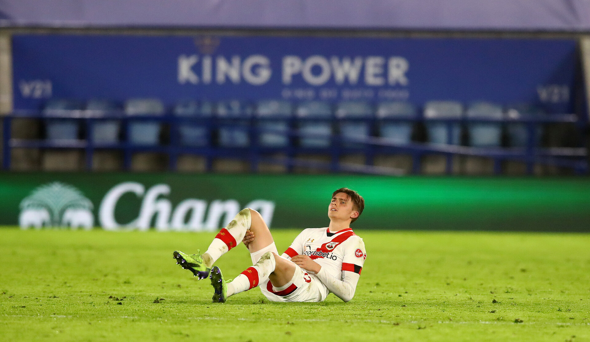 LEICESTER, ENGLAND - JANUARY 16: Will Smallbone of Southampton picks up an injury during the Premier League match between Leicester City and Southampton at The King Power Stadium on January 16, 2021 in Leicester, England. Sporting stadiums around England remain under strict restrictions due to the Coronavirus Pandemic as Government social distancing laws prohibit fans inside venues resulting in games being played behind closed doors. (Photo by Matt Watson/Southampton FC via Getty Images)