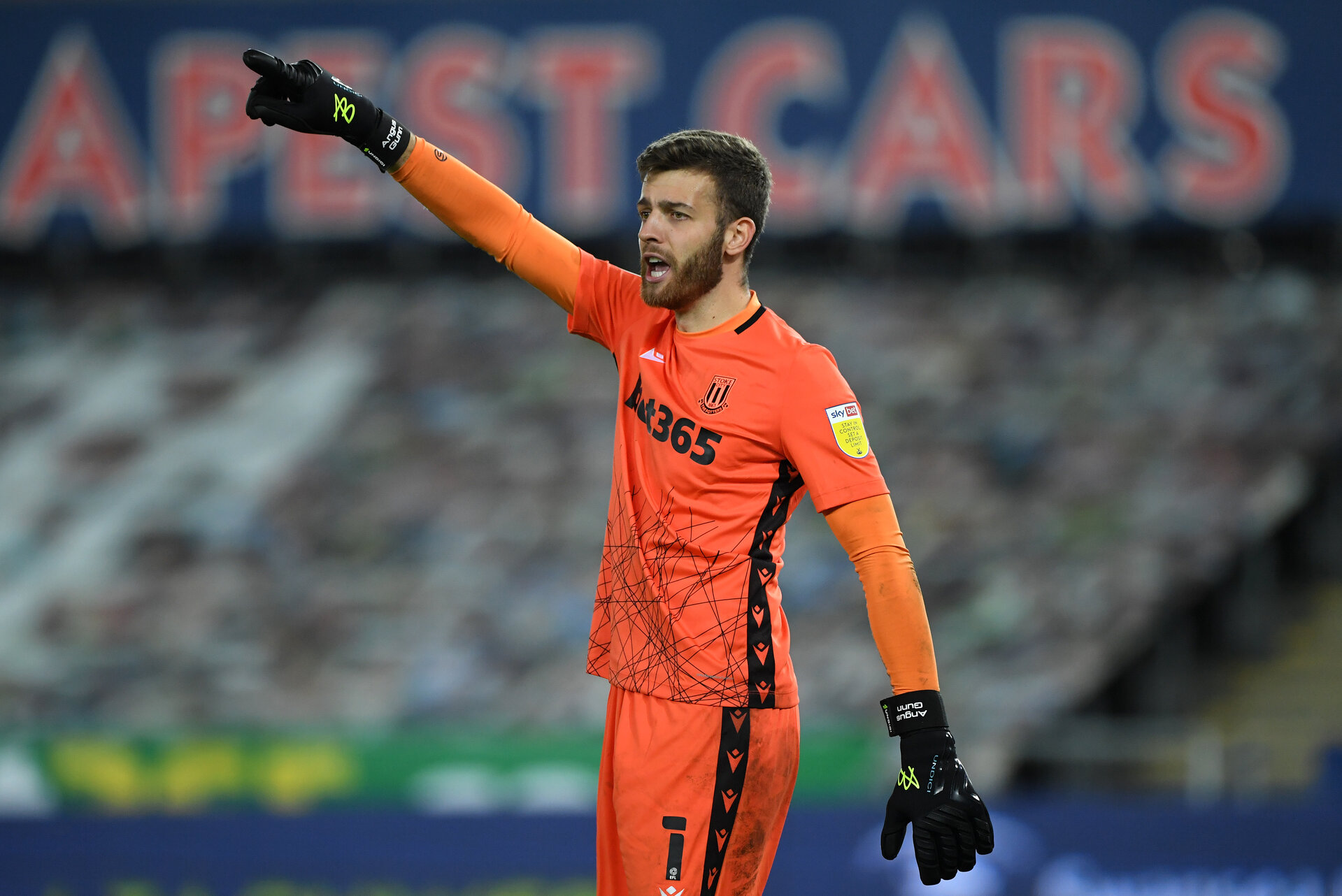 SWANSEA, WALES - OCTOBER 27: Stoke goalkeeper Angus Gunn in action during the Sky Bet Championship match between Swansea City and Stoke City at Liberty Stadium on October 27, 2020 in Swansea, Wales. Sporting stadiums around the UK remain under strict restrictions due to the Coronavirus Pandemic as Government social distancing laws prohibit fans inside venues resulting in games being played behind closed doors. (Photo by Stu Forster/Getty Images)
