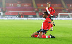 SOUTHAMPTON, ENGLAND - JANUARY 19: Dan N'Lundulu of Southampton celebrates after opening the scoring during the FA Cup Third Round match between Southampton and Shrewsbury Town on January 19, 2021 in Southampton, England. Sporting stadiums around the UK remain under strict restrictions due to the Coronavirus Pandemic as Government social distancing laws prohibit fans inside venues resulting in games being played behind closed doors. (Photo by Matt Watson/Southampton FC via Getty Images)