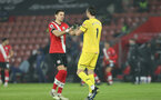 SOUTHAMPTON, ENGLAND - JANUARY 26: Jan Bednarek(L) of Southampton and Alex McCarthy (R) of Southampton during the Premier League match between Southampton and Arsenal at St Mary's Stadium on January 26, 2021 in Southampton, England. Sporting stadiums around the UK remain under strict restrictions due to the Coronavirus Pandemic as Government social distancing laws prohibit fans inside venues resulting in games being played behind closed doors. (Photo by Chris Moorhouse/Southampton FC via Getty Images)