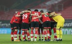 SOUTHAMPTON, ENGLAND - JANUARY 26: Southampton players ahead of the Premier League match between Southampton and Arsenal at St Mary's Stadium on January 26, 2021 in Southampton, England. Sporting stadiums around the UK remain under strict restrictions due to the Coronavirus Pandemic as Government social distancing laws prohibit fans inside venues resulting in games being played behind closed doors. (Photo by Chris Moorhouse/Southampton FC via Getty Images)