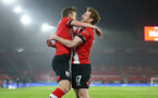 SOUTHAMPTON, ENGLAND - JANUARY 26: James Ward-Prowse (L) of Southampton celebrates with Stuart Armstrong (R) of Southampton after scoring during the Premier League match between Southampton and Arsenal at St Mary's Stadium on January 26, 2021 in Southampton, England. Sporting stadiums around the UK remain under strict restrictions due to the Coronavirus Pandemic as Government social distancing laws prohibit fans inside venues resulting in games being played behind closed doors. (Photo by Matt Watson/Southampton FC via Getty Images)