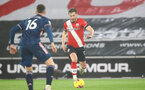 SOUTHAMPTON, ENGLAND - JANUARY 26: Stuart Armstrong of Southampton during the Premier League match between Southampton and Arsenal at St Mary's Stadium on January 26, 2021 in Southampton, England. Sporting stadiums around the UK remain under strict restrictions due to the Coronavirus Pandemic as Government social distancing laws prohibit fans inside venues resulting in games being played behind closed doors. (Photo by Matt Watson/Southampton FC via Getty Images)